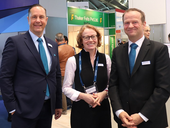 Pictured at Techtextil 2019 in Frankfurt is Dr Heislitz (right) with Freudenberg Performance Materials head of global communications Holger Steingraeber and media relations manager Katrin Böttcher. © Adrian Wilson