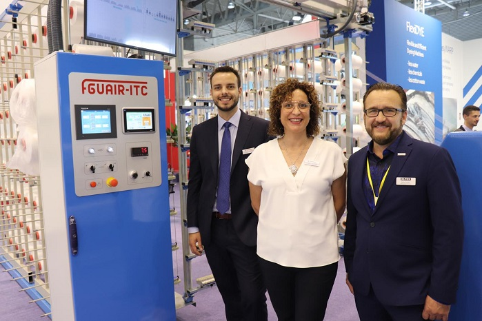 Ferran and Isabel Mataró, of Comsat, with Brian Hicks, of Eltex, at ITMA 2019 in Barcelona. © Eltex