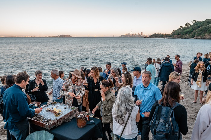 Guests mixed and mingled on Angel Island while enjoying locally sourced seafood. © Russ Levi Photography