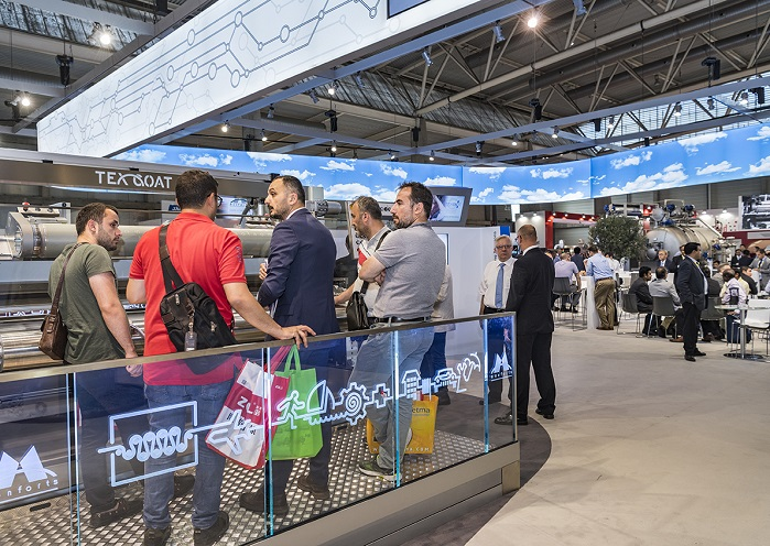 The busy Monforts stand at this year's ITMA textile machinery exhibition. © Monforts
