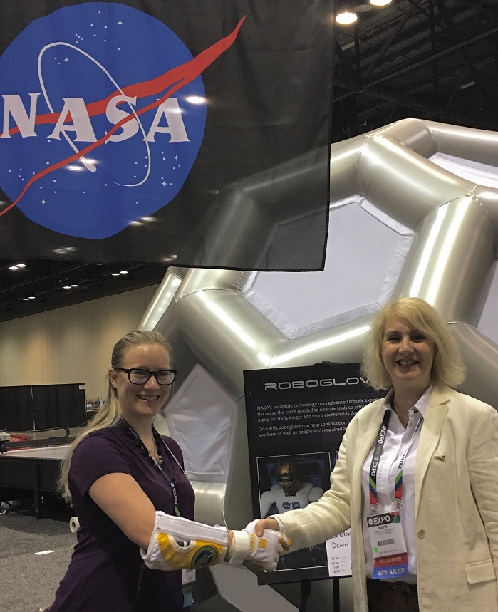 Shaking hands with NASA's Emily McBryan and Robo-Glove. © Marie O'Mahony