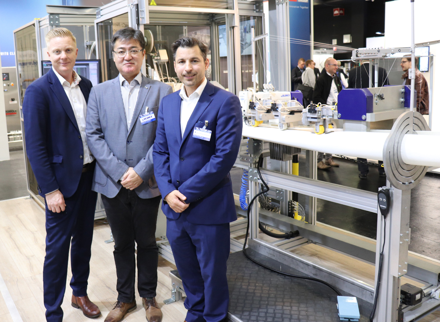Pictured (left to right) are ACG Nyström Vice-President Thomas Arvidsson, Christian Moore, CEO of ACG Kinna, and Masanori Awasaki, President of Juki Central Europe.