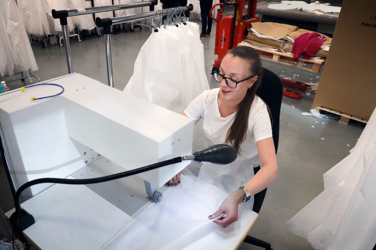 "Jessica Eckerström usually works at ACG Group's Eskil printing plant, which has reduced order intake She is now working on the production of protective garments. ""It great to be able to help, and fun too,"" she says. Image courtesy of BoråsTidning."