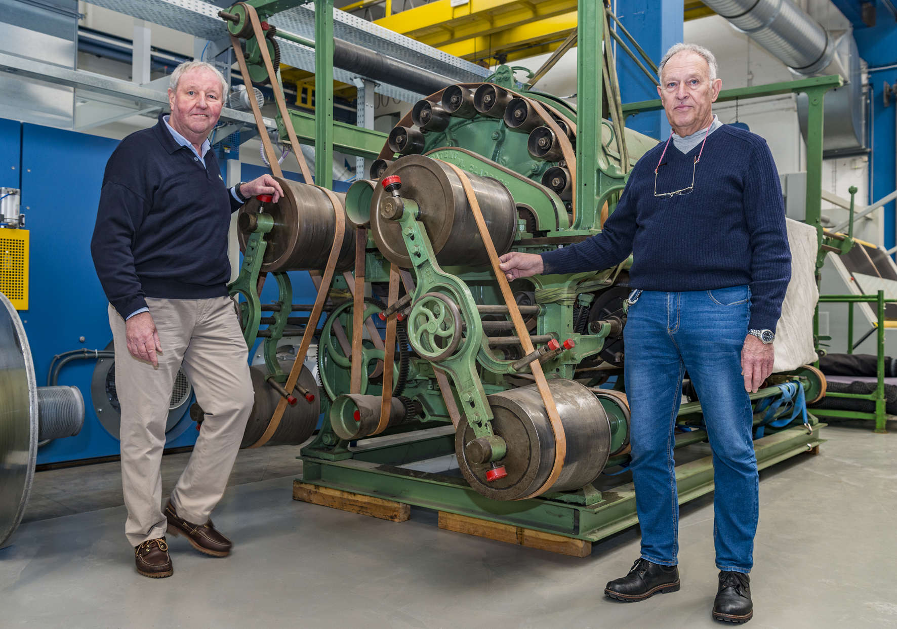 Fred Vohsdahl (left) and Walter Dresen with the103-year-old Monforts machine. © Monforts.