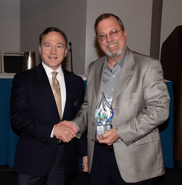 (left-to-right) Dave Rousse, INDA President, presents the RISE Durable Product Award to Steve Chester, Technical Service & Development Manager, Fitesa Simpsonville. © INDA