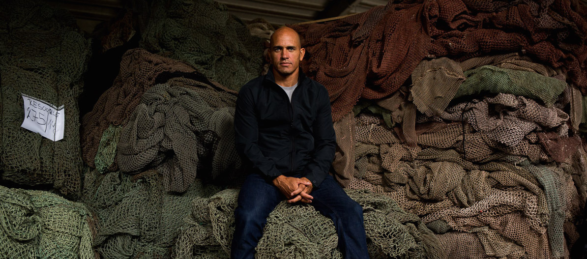 Kelly Slater sits with fishing nets like those collected for Outerknown at the ECONYL manufacturing plant (Photo: Business Wire).