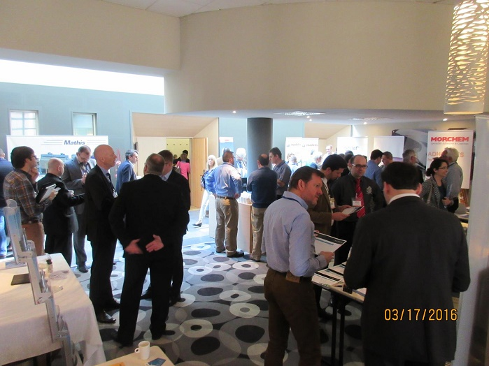 Attendees at break networking and viewing displays. © TCL2016