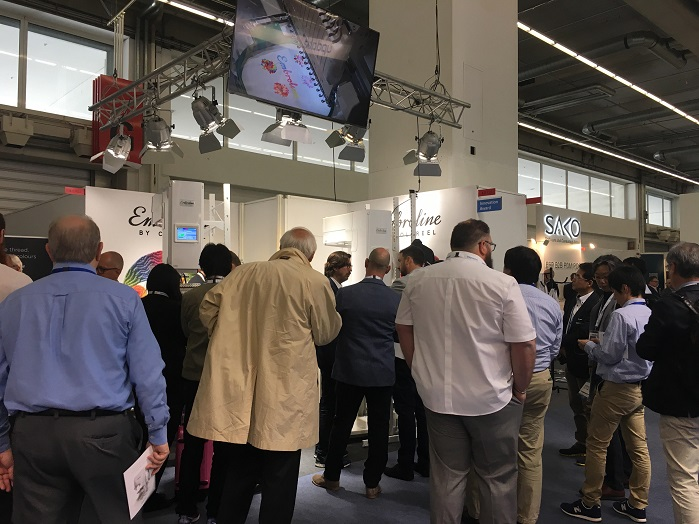 Visitors crowd the Coloreel booth at Texprocess. © Innovation in Textiles