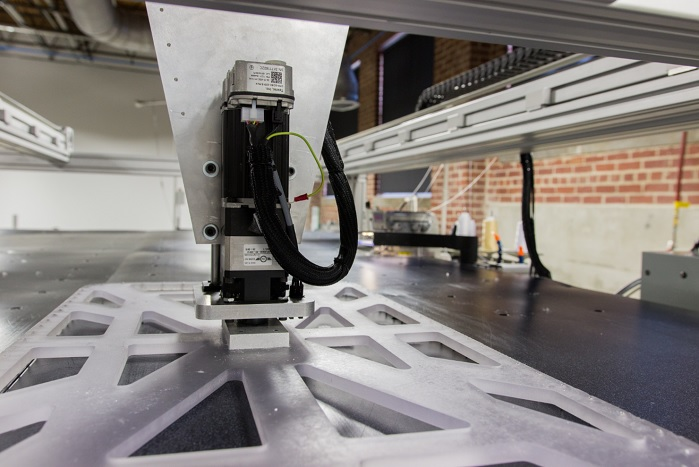 Using cameras to map the fabric and robots to steer it through the sewing needles, the system will handle soft fabrics and make the T-shirts for Adidas. © SoftWear Automation