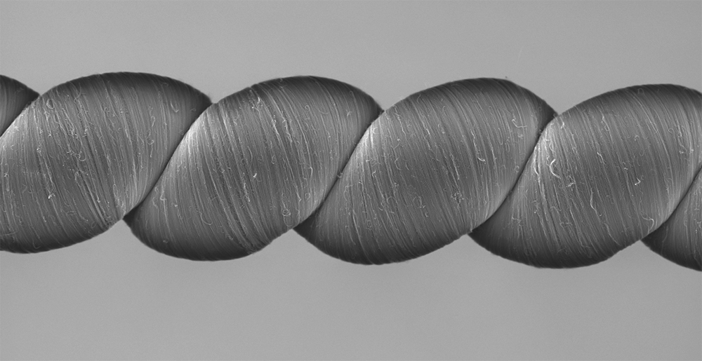 Coiled carbon nanotube yarns, created at The University of Texas at Dallas and imaged here with a scanning electron microscope, generate electrical energy when stretched or twisted. © The University of Texas at Dallas