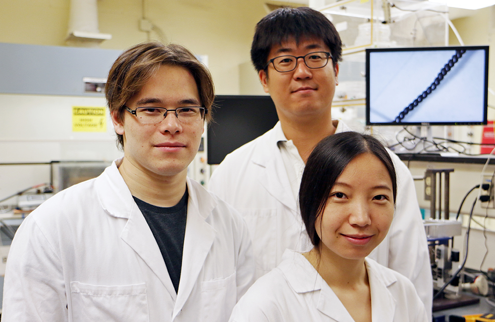 From left: Dr Carter Haines BS'11, PhD'15, Dr Shi Hyeong Kim and Dr Nai Li  of the Alan G. MacDiarmid NanoTech institute at UT Dallas are lead authors of a study that describes carbon nanotube yarns that generate electricity when they are stretched or twisted. © The University of Texas at Dallas