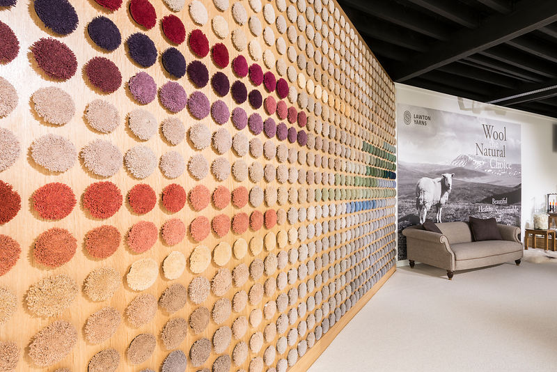 The space features a 'wall of colour' with 800 poms of coloured woollen yarn. © Lawton Yarns