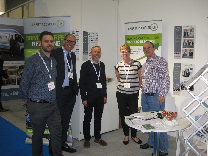 CRUK members James Bagdadi, of DESSO; David, Dawn and Bill, from Clinton Carpets; with Robert Barker, of CRUK. © CRUK