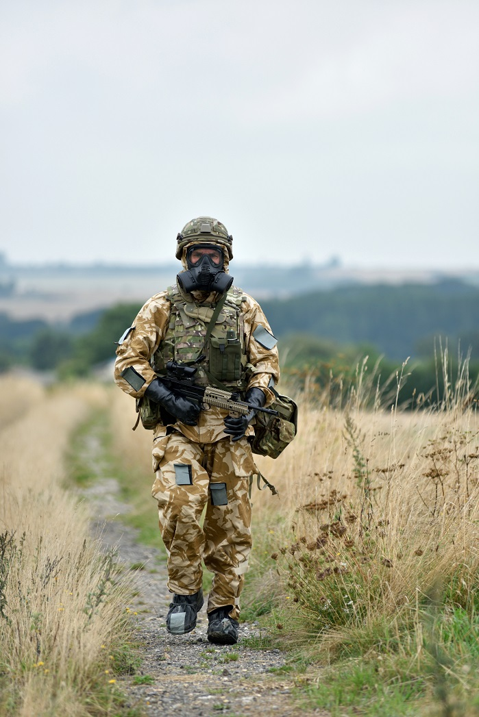 Pictured is a solider on a foot patrol wearing a full CBRN Individual Protective Equipment (IPE) including the Mk IVA CBRN suit and the General Service Respirator (GSR). © Martin Jones/MOD