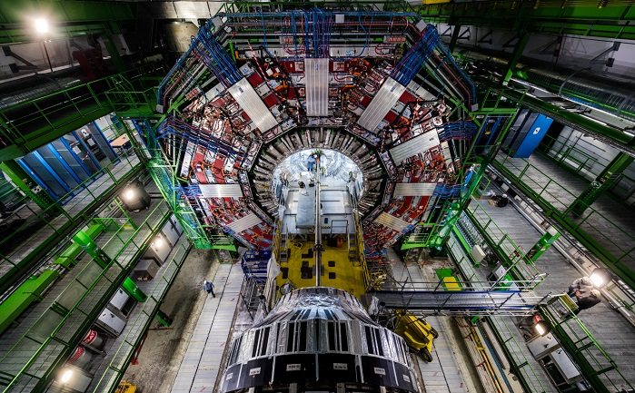 The 14,000 tonne, 21 m long Compact Muon Solenoid detector acts as a giant, high-speed camera, taking 3D 'photographs' of particle collisions up to 40 million times each second. Each particle position measurement is accurate to 10 µm, a fraction of the width of a human hair. © CERN