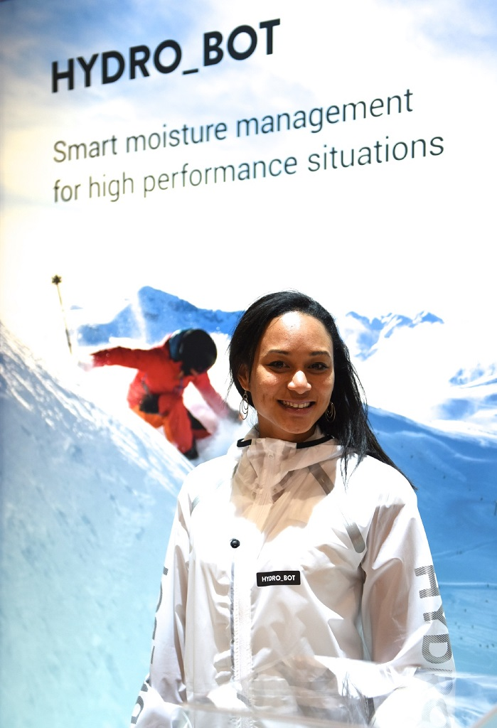 Senior scientist Stephanie Say-Liang-Fat from Osmotex with the Hydro_Bot prototype jacket being showcased at ISPO in Munich this week. © Osmotex