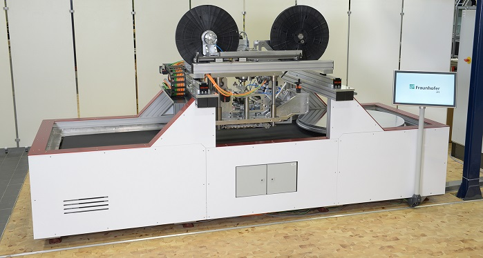 PrePro 2D machine system for tape placement of tailored blanks and laminates with in-situ consolidation. © Fraunhofer IPT