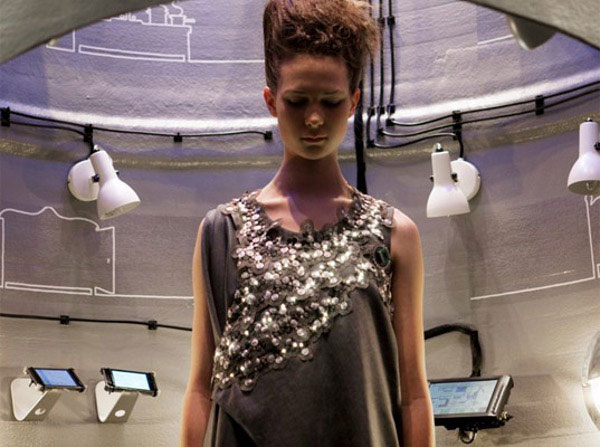 The Climate Dress features Foster Rohner's embroidered Solar Sequins which light up when sensing CO2.