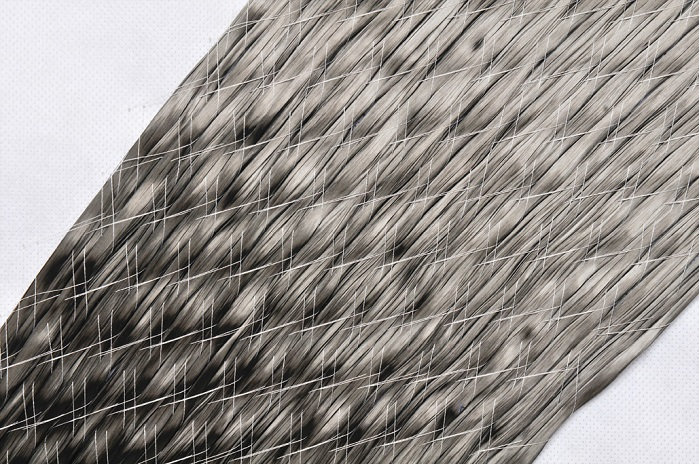 In many hand lay-up processes that use carbon fibre woven material, waste materials can easily account for 50% or more of the total weight of carbon used. © ZSK USA