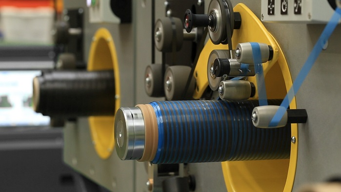 The machine can slit up to 50 metres of prepreg per minute and create up to 48 tapes at once. © Cygnet Texkimp